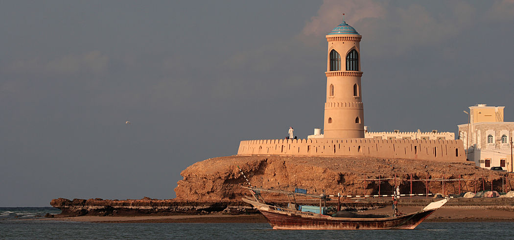 Oman lighthouse dhow dreamstime l 16399261 opt