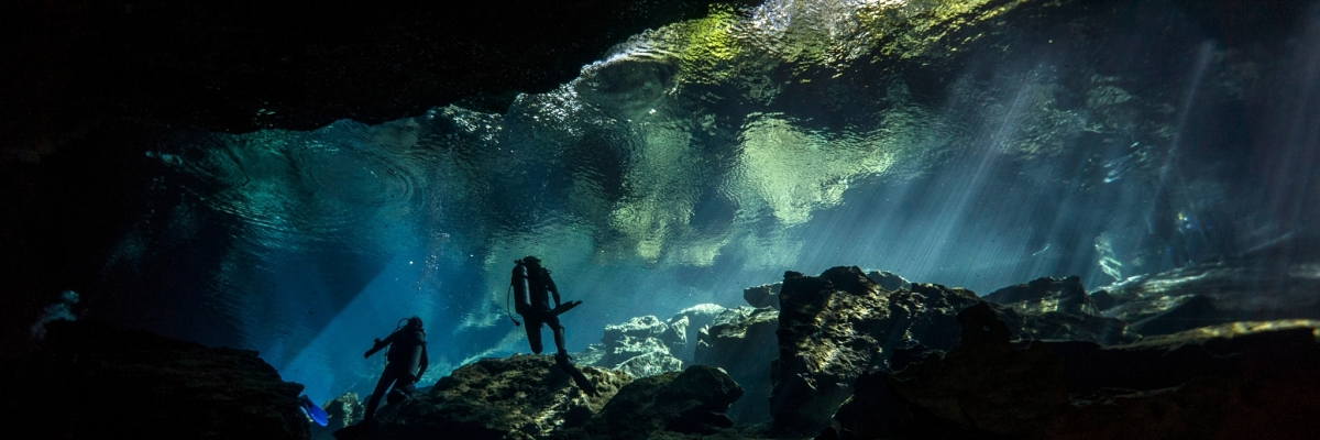 x divers cave sunrays shutterstock 1234333891b opt
